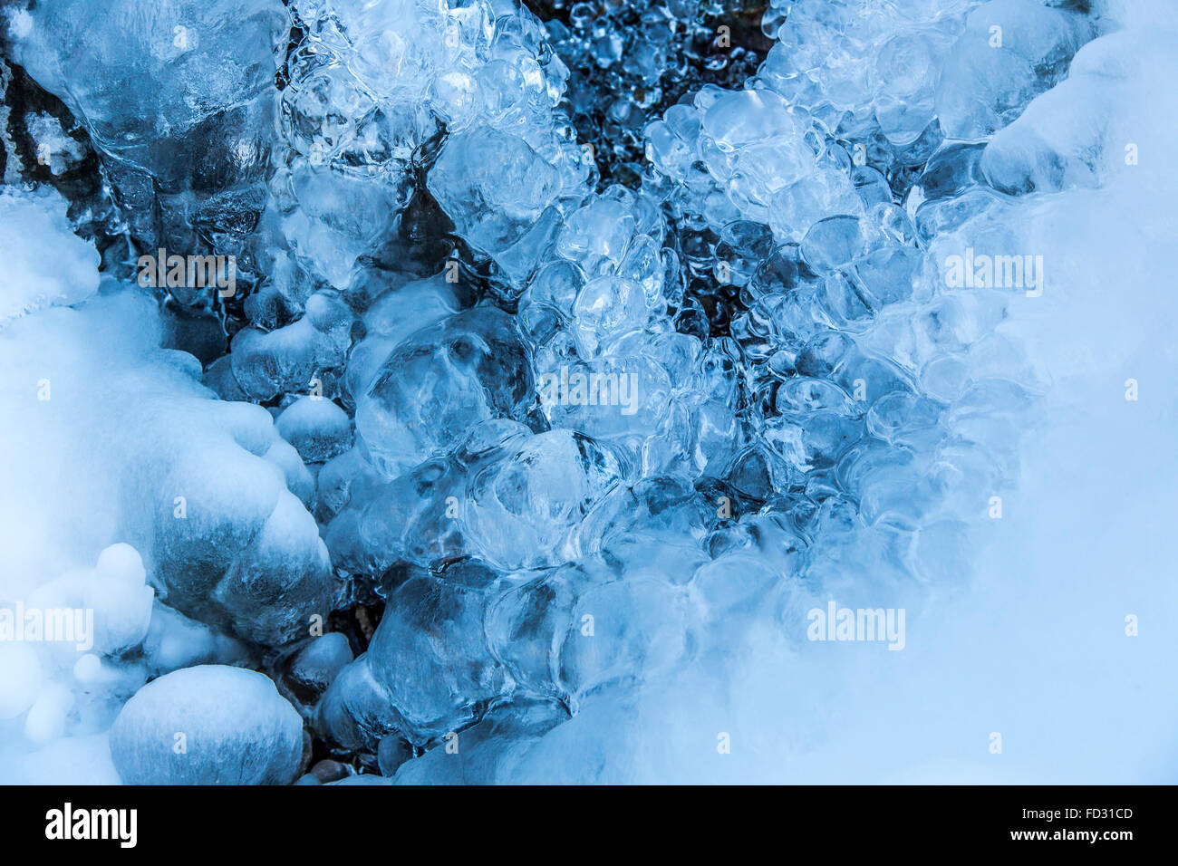 Frozen creek, frozen water, drops, ice in a stream, winter, Sauerland area, Germany Stock Photo