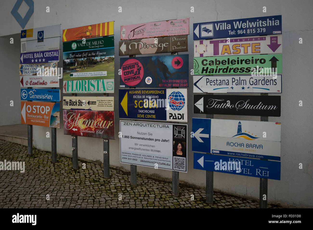 Tourist signs and directions in the Algarve holiday resort town of Carvoeiro - Stock Image