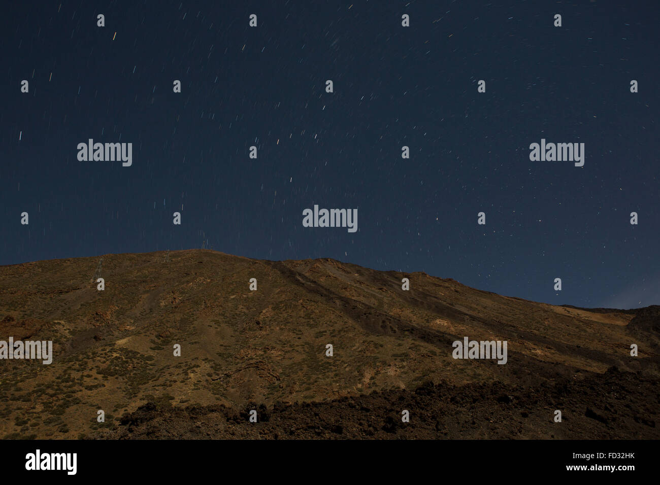 Stars in the night sky above Mount Teide in Teide National Park on Tenerife, Spain. - Stock Image