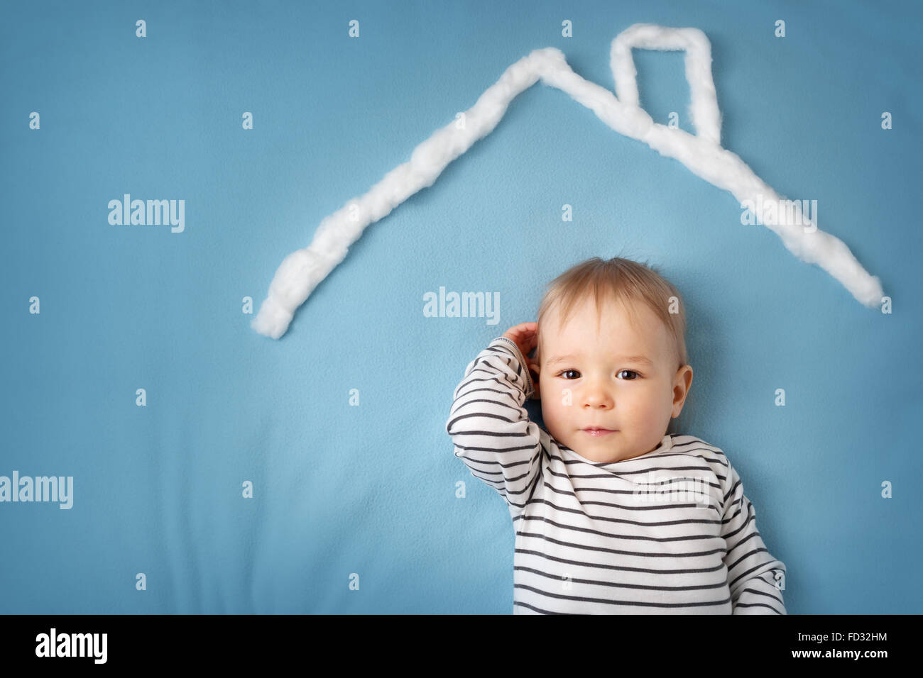 little boy with lots of question marks - Stock Image