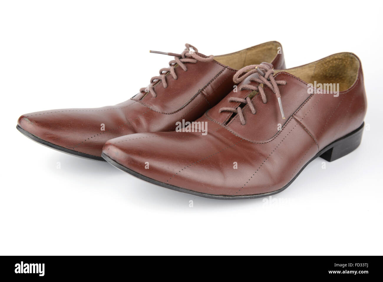 Men accessories, Brown leather medallion toe wholecuts shoes, isolated white background - Stock Image