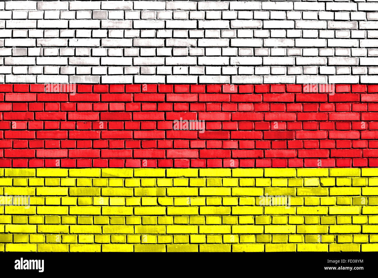 flag of North Ossetia painted on brick wall - Stock Image