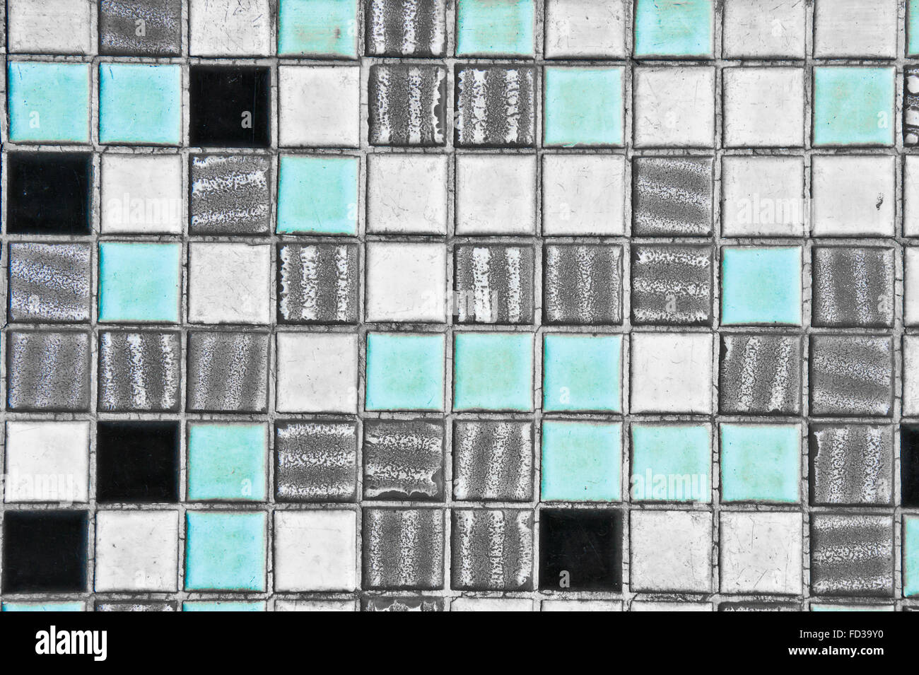 A wall of old blue, white,grey and black tiles as a background image ...