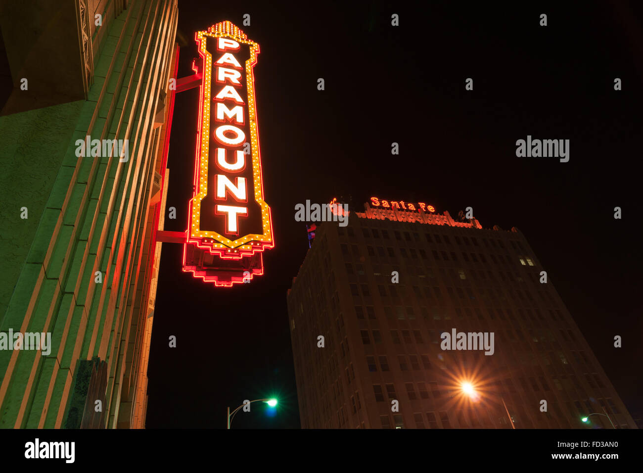 Urban neon signs and lighting historic Paramount Theater built in 1932 and Santa Fe building sign originally office - Stock Image