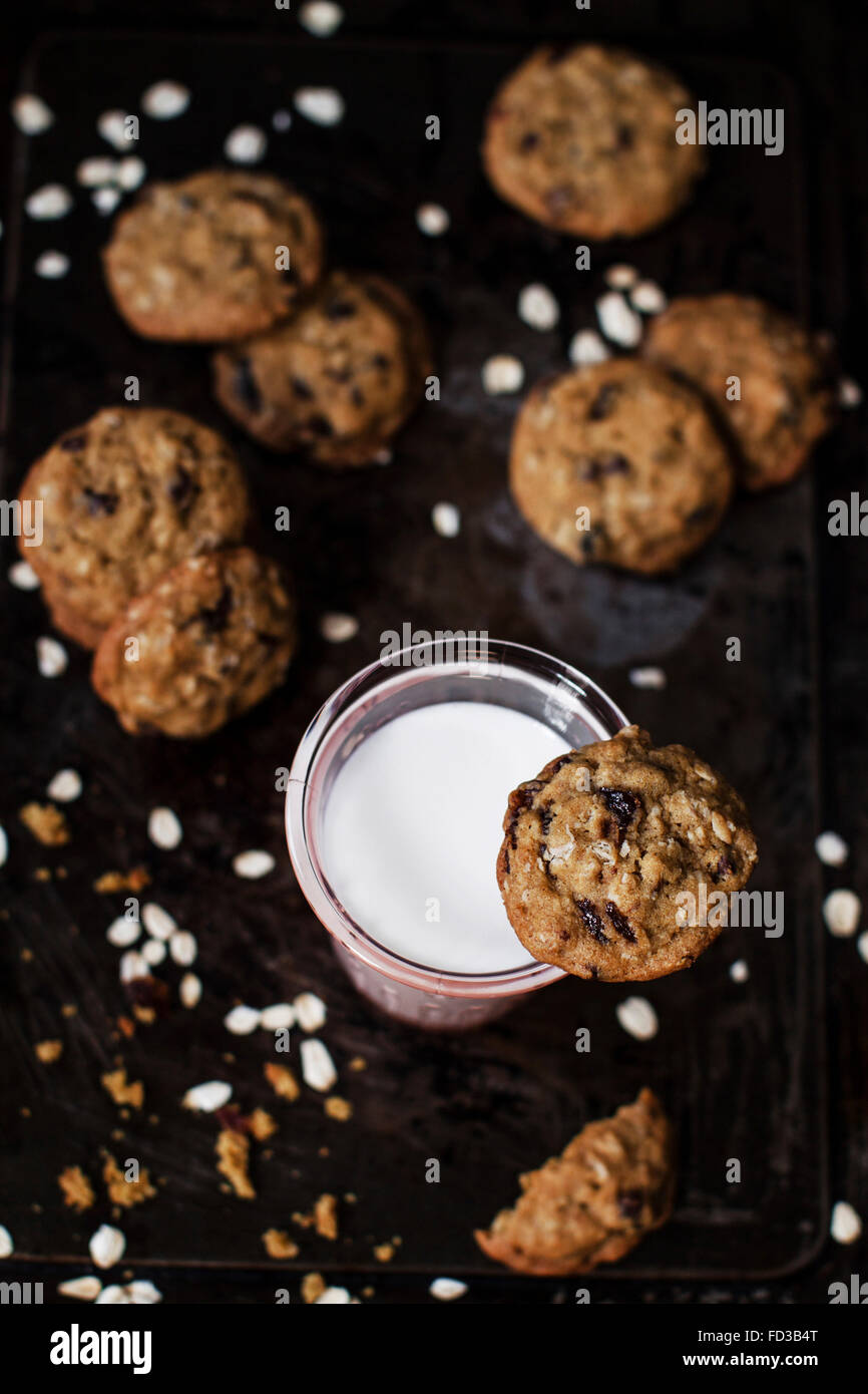 Rich oat cookies with raisin and chocolate chips, having crunchy edges and flavorful chewy center. Set up onto a - Stock Image