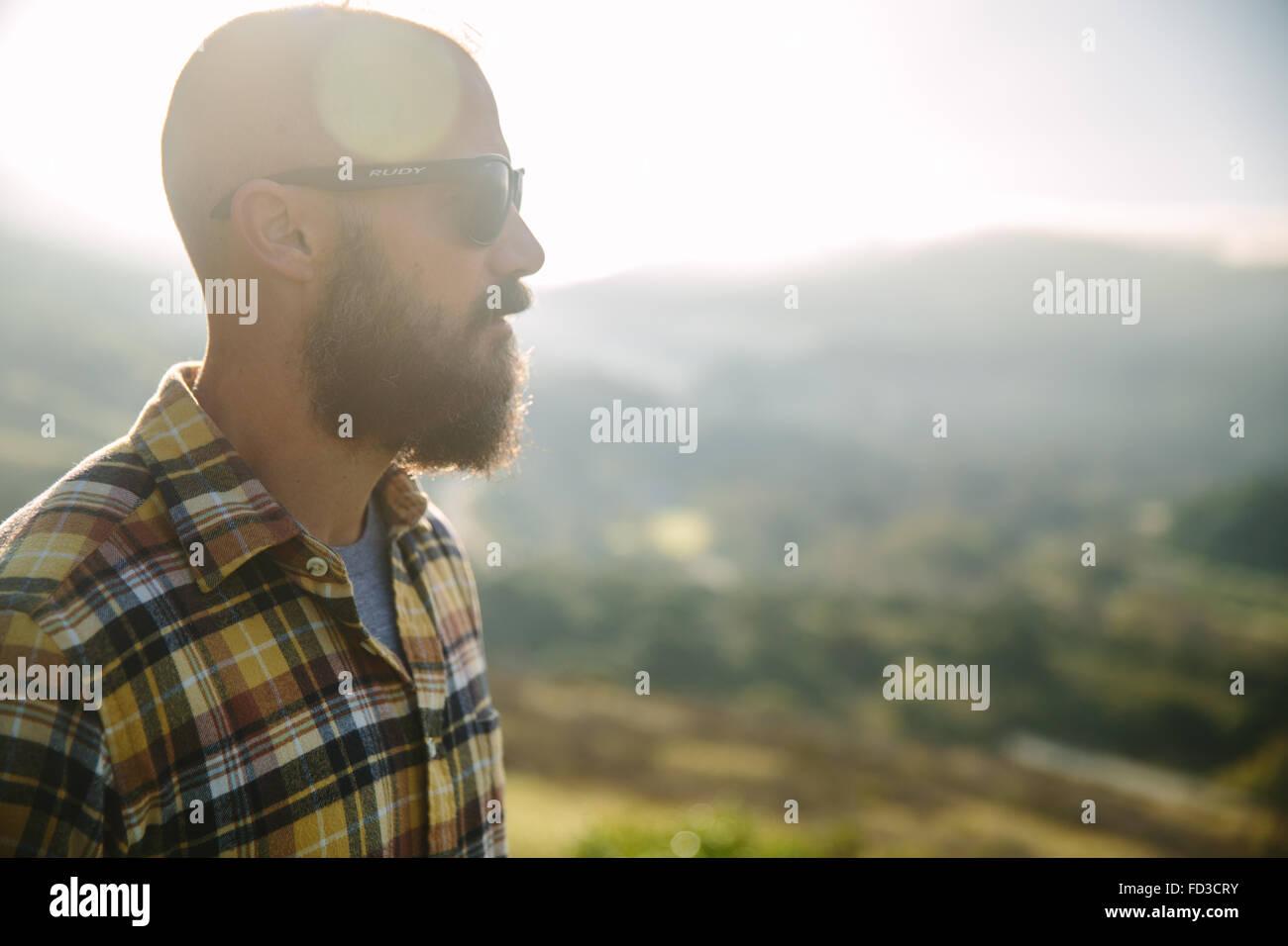 A young man explores Big Sur, California. - Stock Image