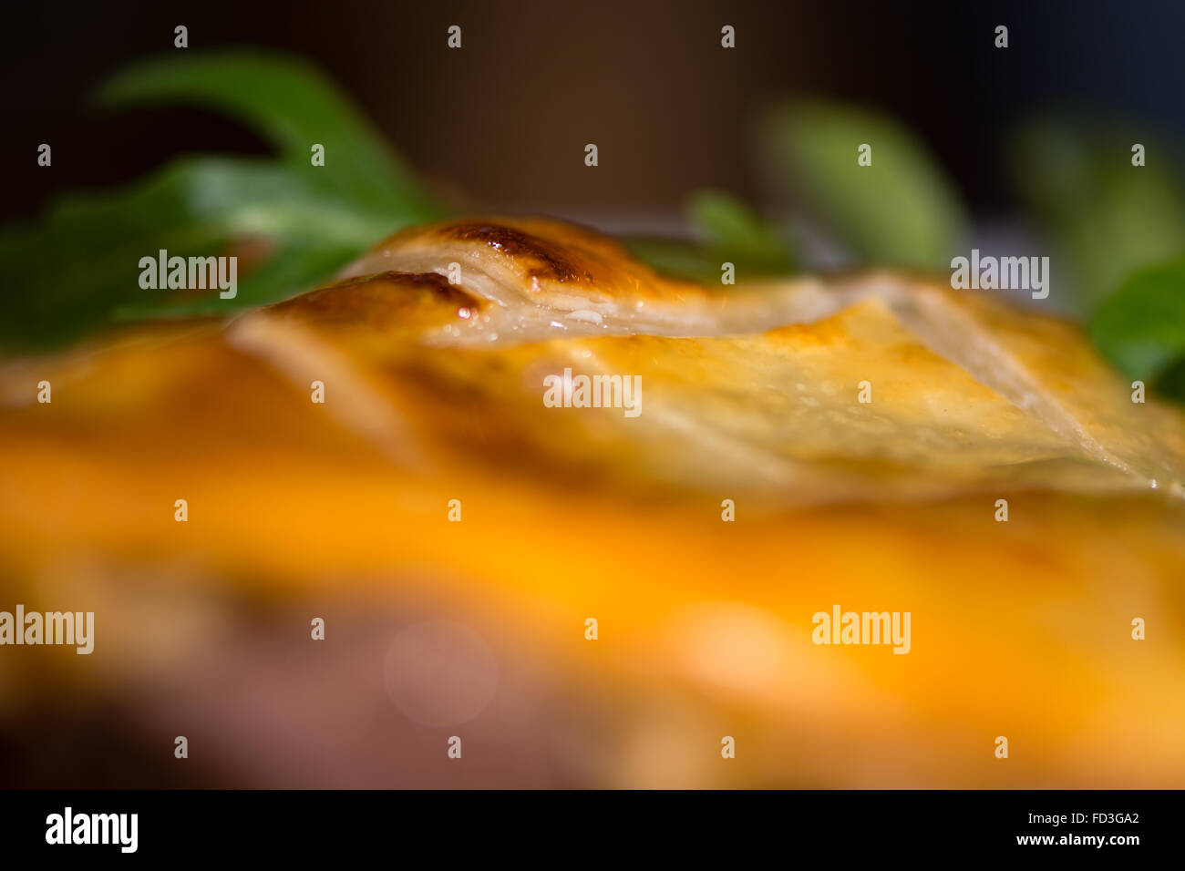 Pastry crust on steak and kidney pie. French restaurant prepared cuisine influenced by a traditional English recipe - Stock Image
