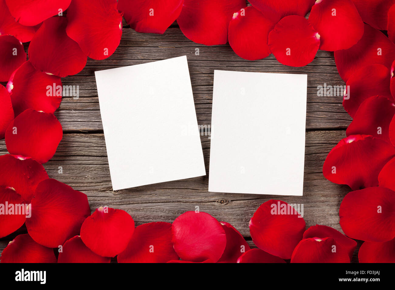 Valentines day blank photo frames over wooden background and red ...