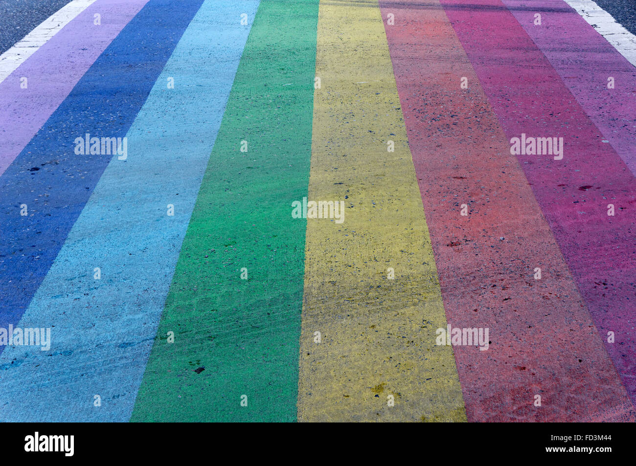 Rainbow crosswalk symbolic of gay pride in the downtown West End of Vancouver, BC, Canada - Stock Image