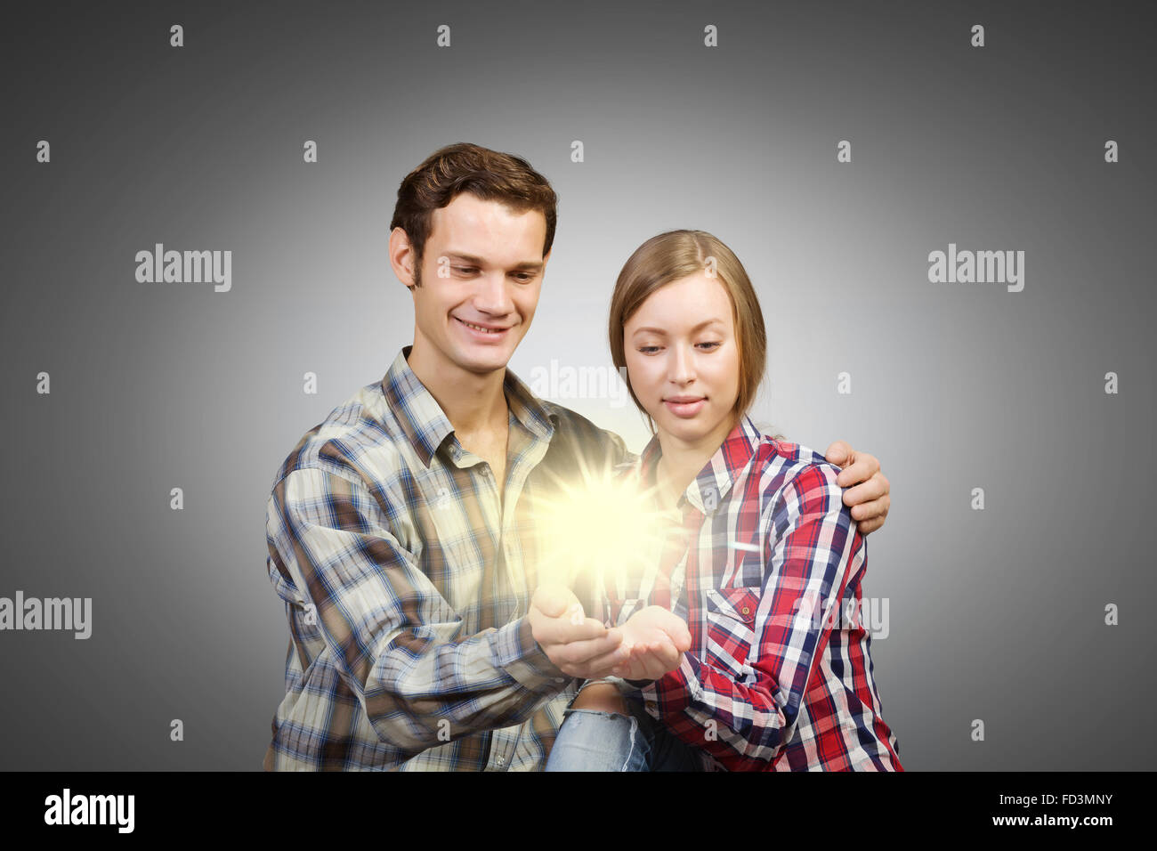 Young happy couple hugging each other tenderly - Stock Image