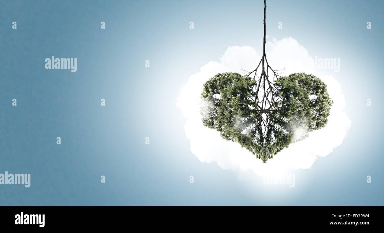 Conceptual image of green tree shaped like heart - Stock Image