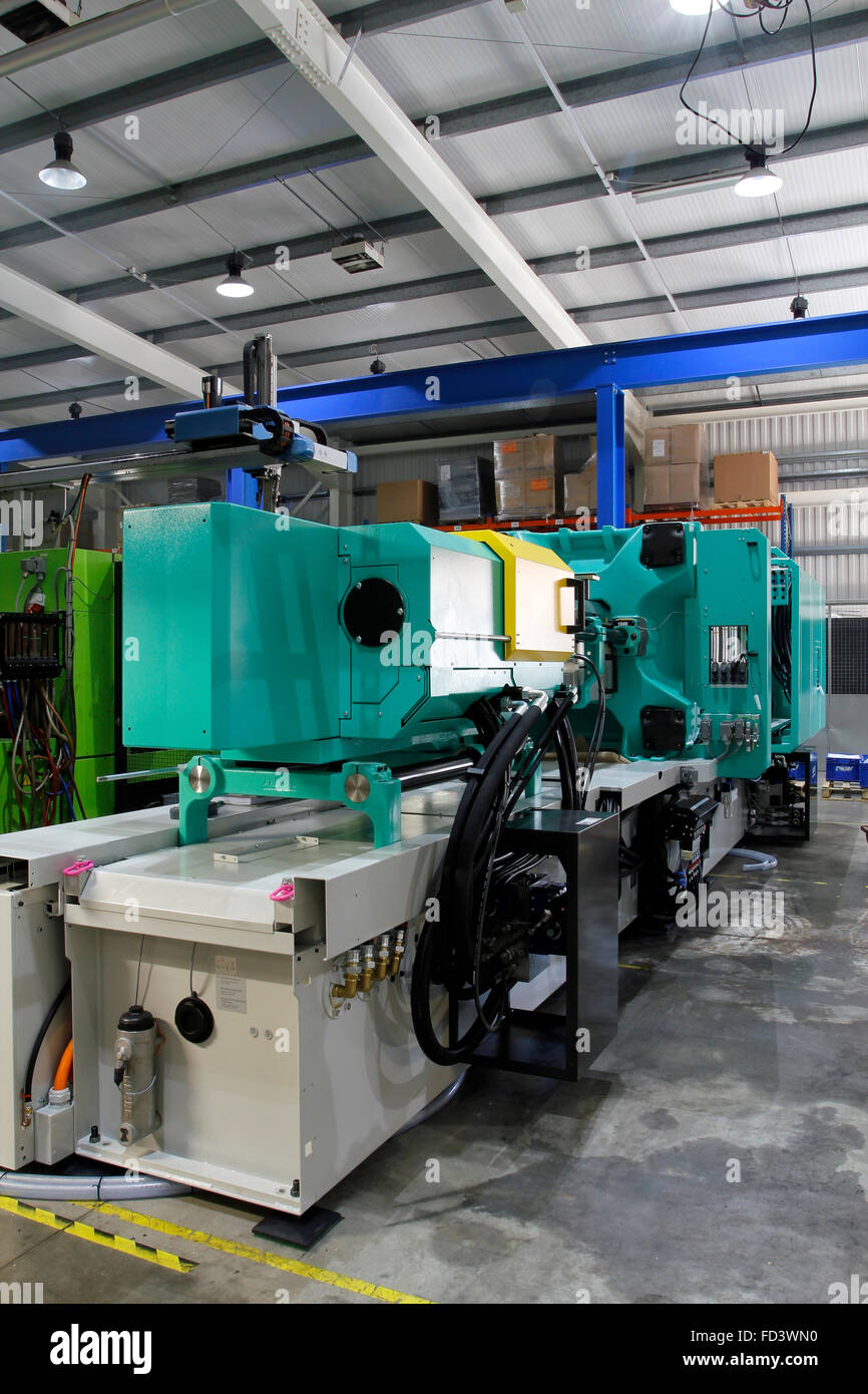 Injection moulding machine used for the forming of plastic parts using plastic resin and polymers. - Stock Image