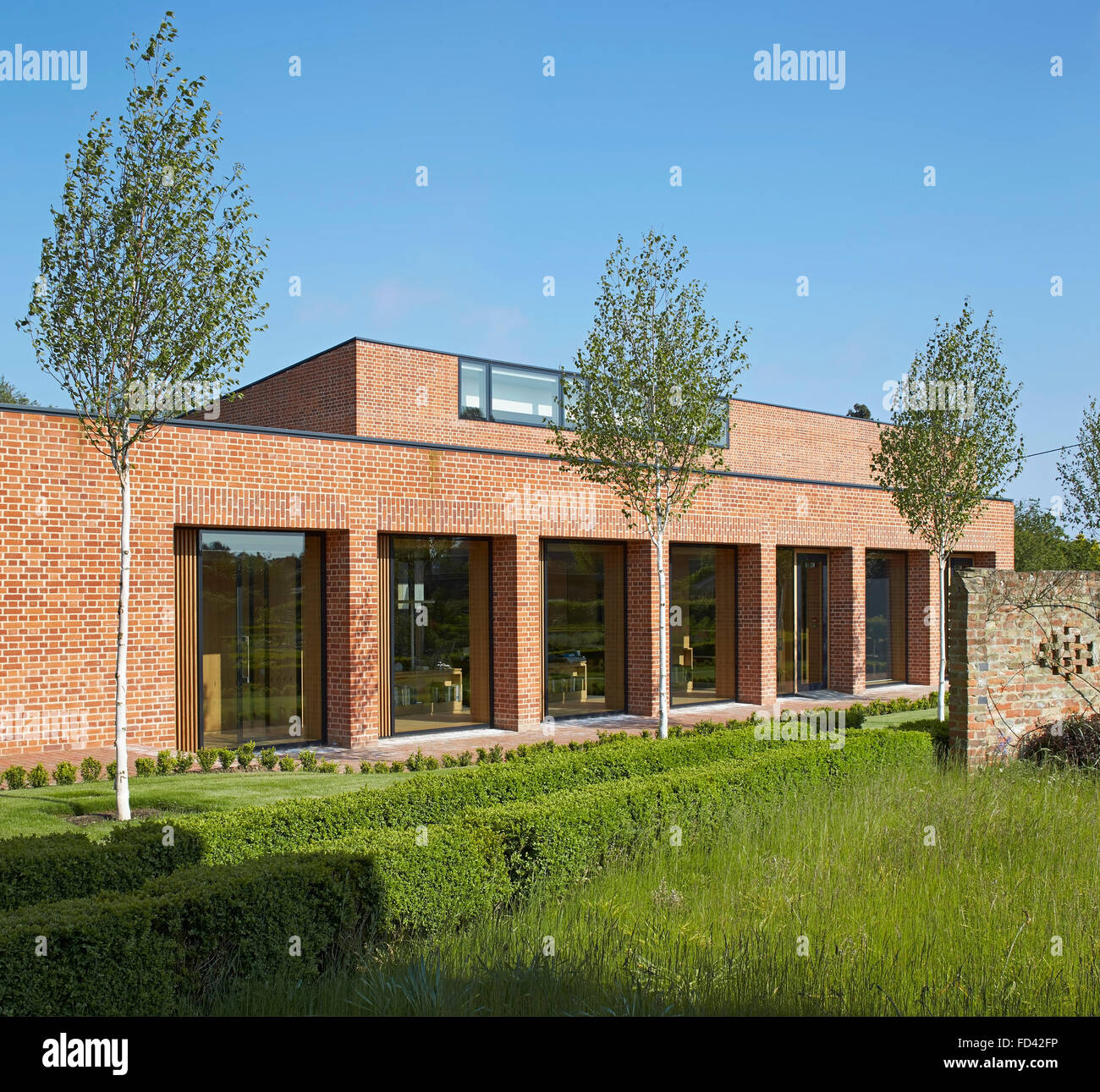 Brick piers with recessed full-height windows. Britten-Pears Archive, Aldeburgh, United Kingdom. Architect: Stanton - Stock Image