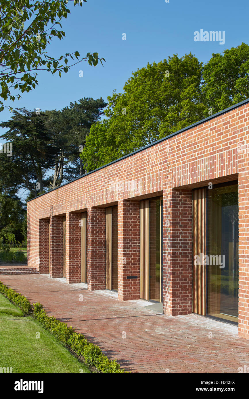 Perspective of brick piers with recessed full-height windows. Britten-Pears Archive, Aldeburgh, United Kingdom. - Stock Image