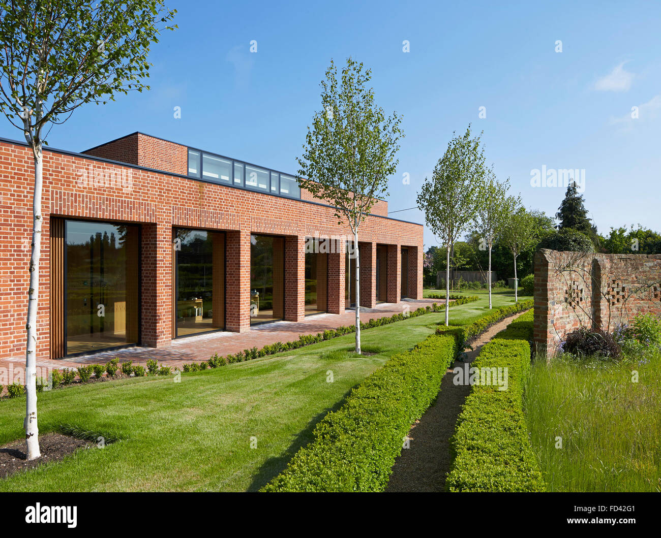 Facade perspective with recessed full-height windows. Britten-Pears Archive, Aldeburgh, United Kingdom. Architect: - Stock Image
