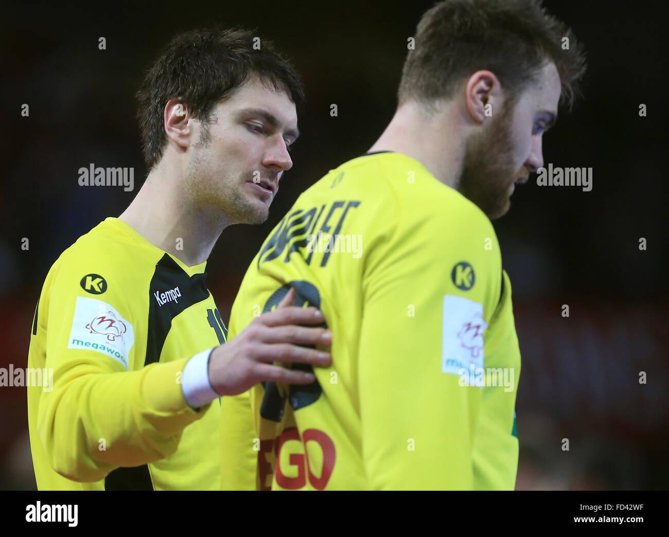 1b71b0696a7056 Germany s goalkeeper Carsten Lichtlein (L) coaches team mate Andreas Wolff  during the 2016 Men s European Championship handball group 2 match between  ...