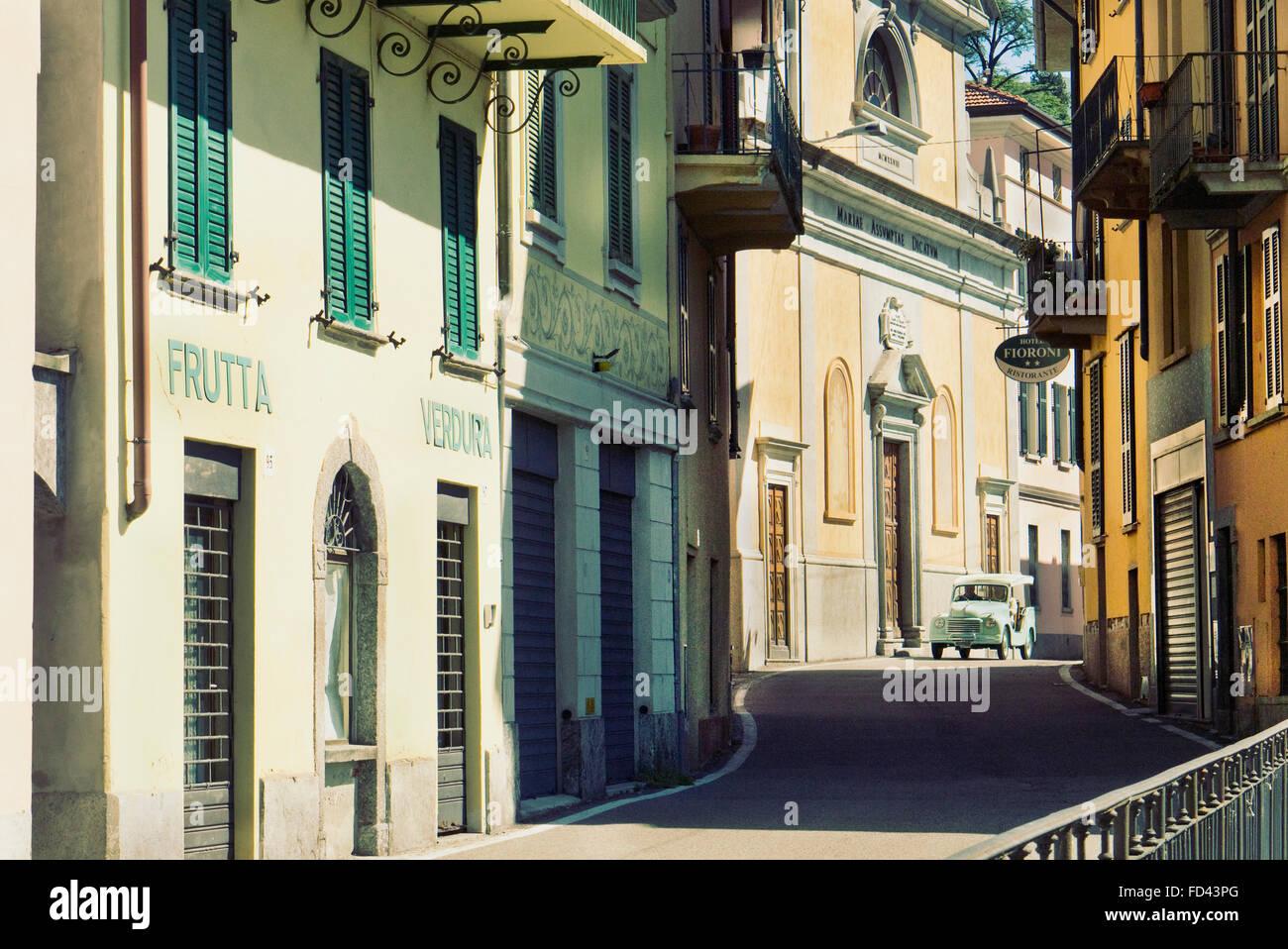 1954 Fiat Topolino Jolly beach automobile driving through an Italian village on Lake Como. - Stock Image