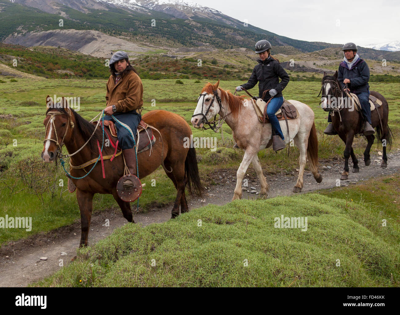 Three horse riders in Patagonia, Chile - Stock Image