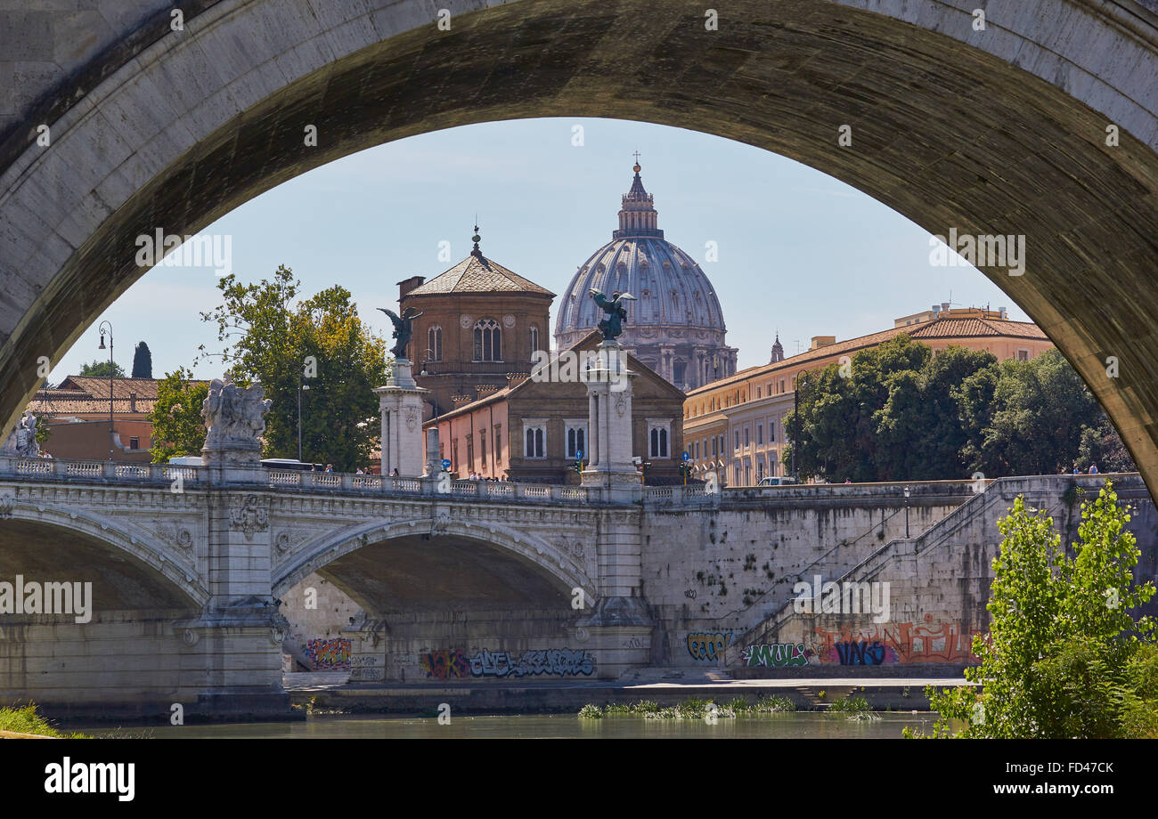 Dome of St Peter's Basilica through arch of bridge on the River Tiber (Tevere), Rome Lazio Italy Europe - Stock Image