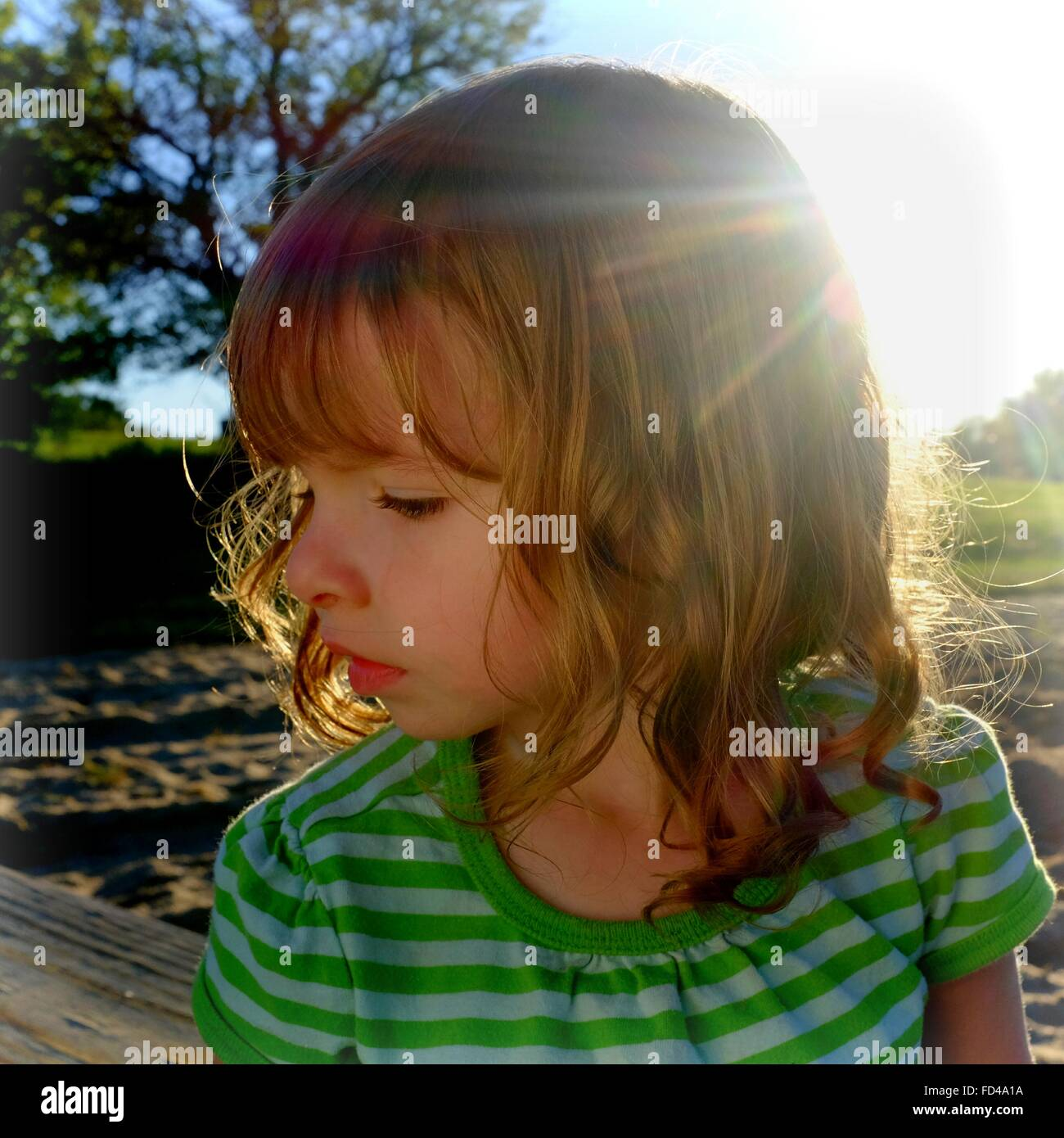 Close-Up Of Cute Girl In Park - Stock Image