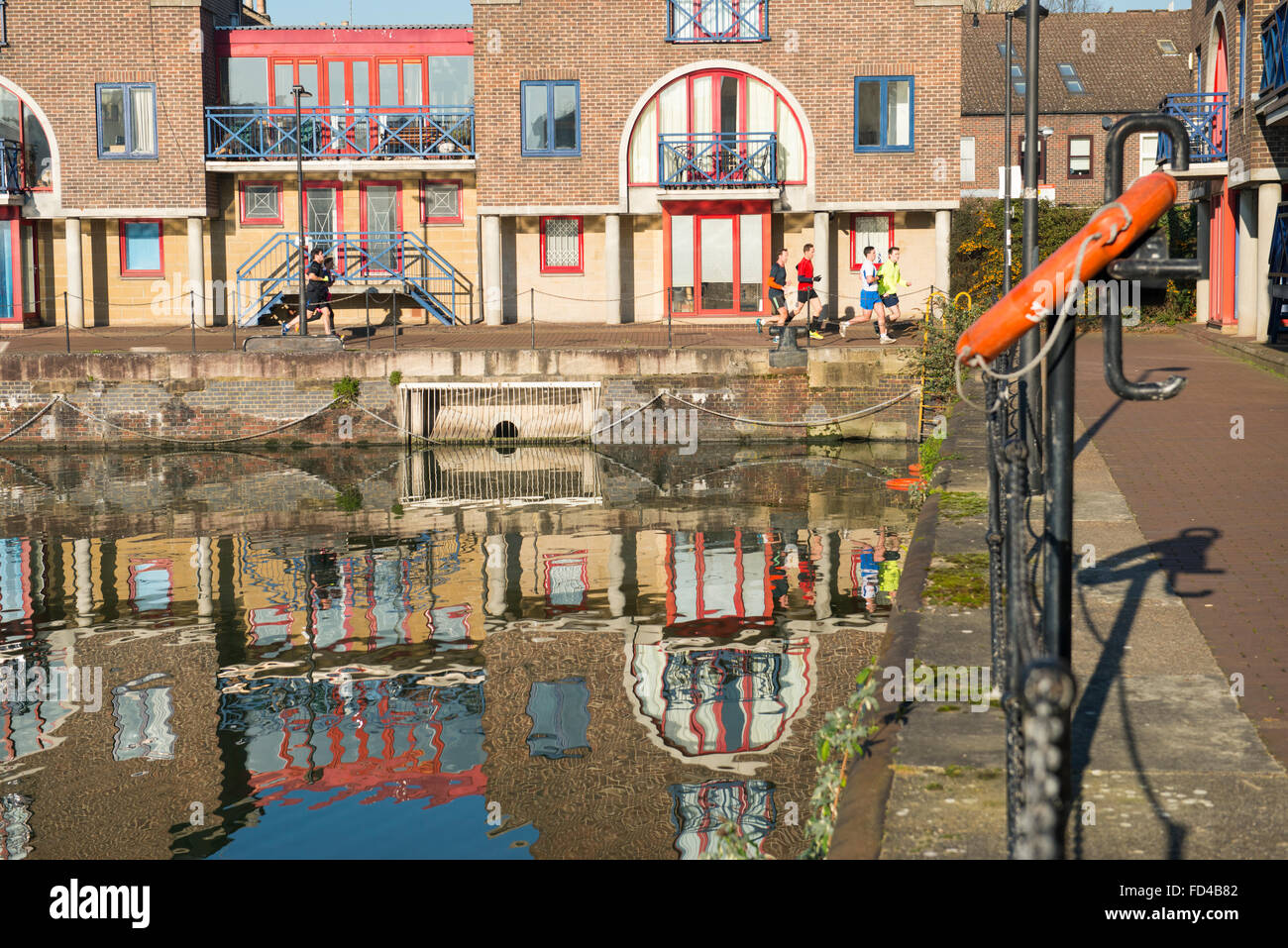 London Docks East End Wapping Shadwell Basin Entrance life buoy water lifebuoy ring reflection detail dockside scene - Stock Image