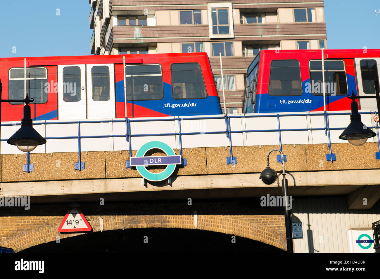 East End Wapping Shadwell DLR train bridge over road TFL Transport for London subway Metro Docklands Light Railway Stock Photo