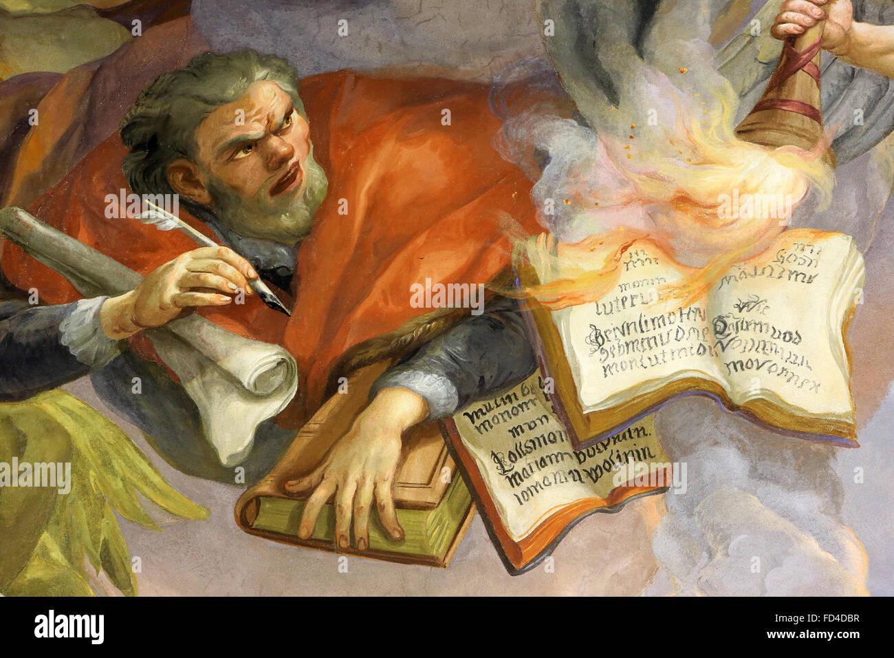 An angel burn Luther's writings. Fresco by Johann Michael Rottmayrr. Karlskirche. St. Charles's Church. - Stock Image