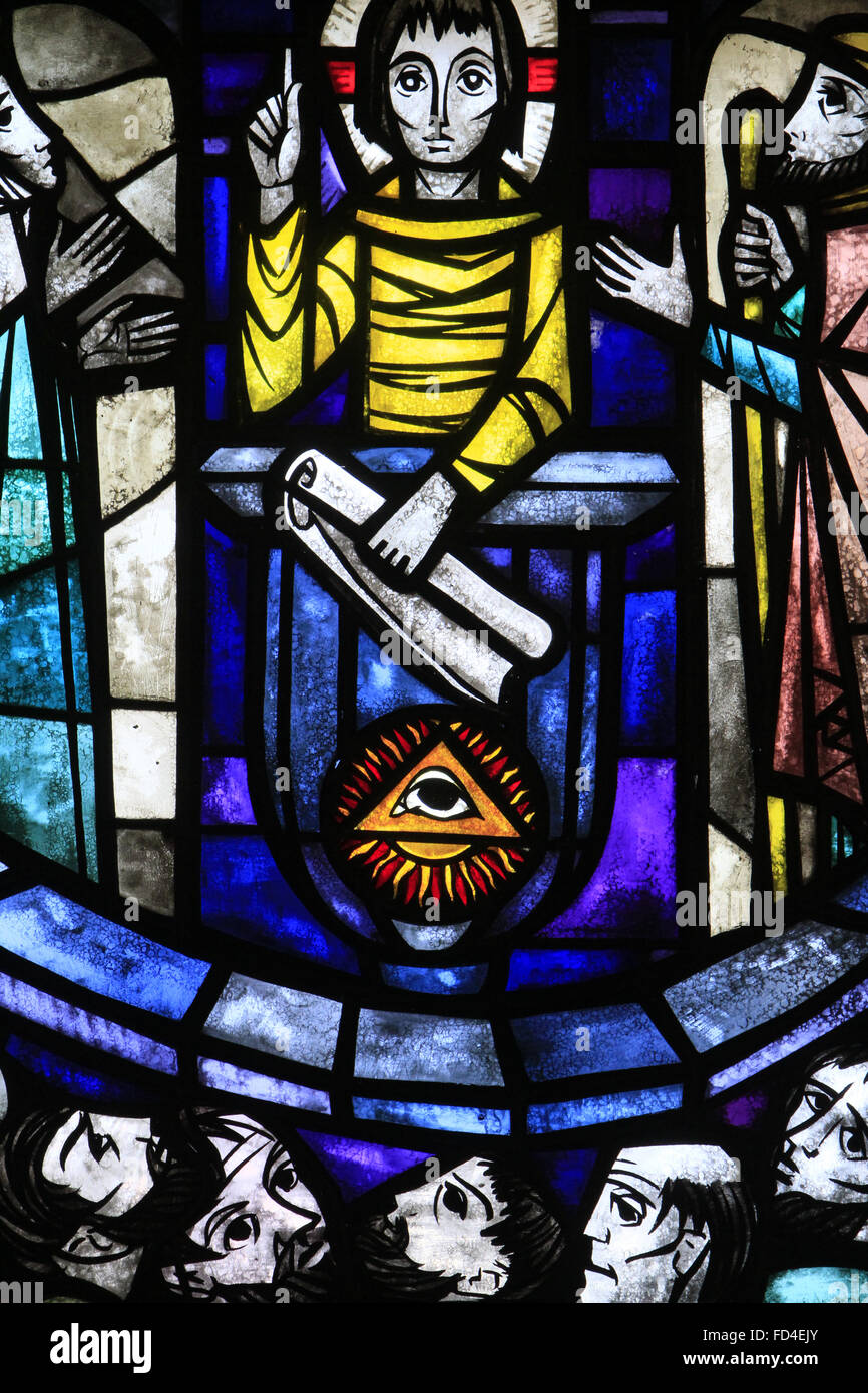 The Eye of Providence, emphasizing the triangle representing the Trinity. Jesus teaches in the temple. Stained-glass - Stock Image