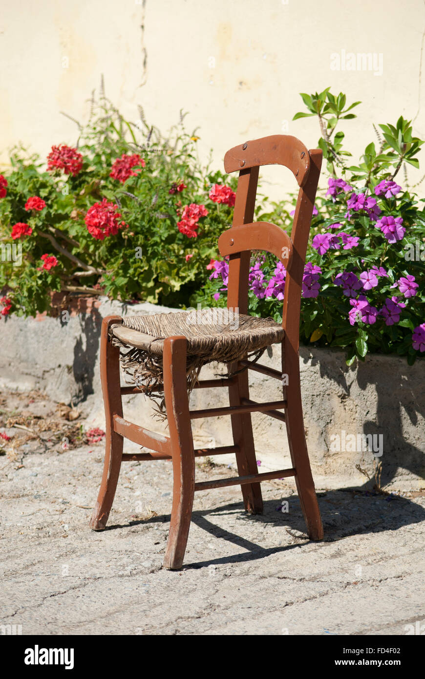 Old distressed Chair at Rethymnon Crete Stock Photo