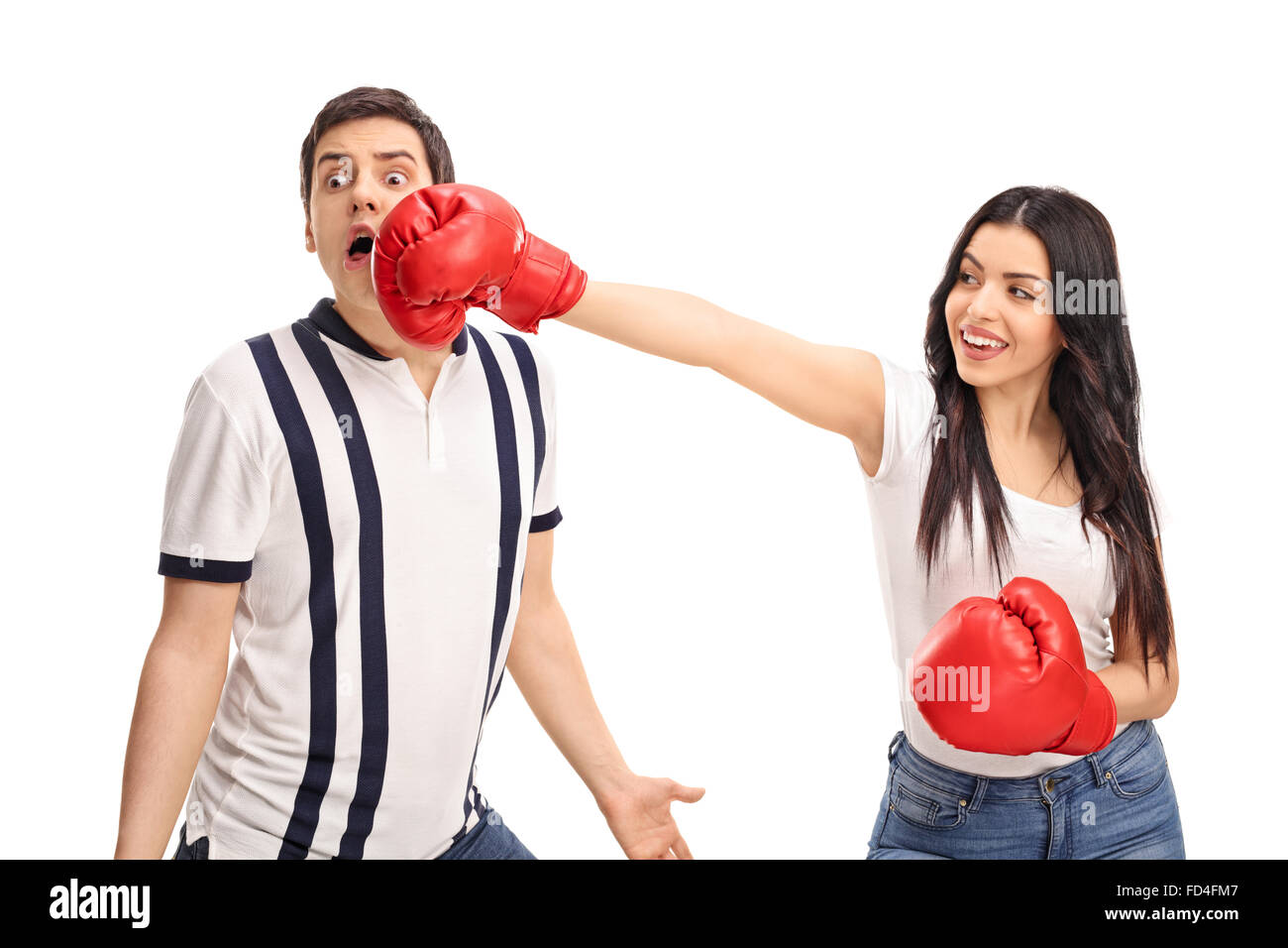 Cheerful woman punching her boyfriend with boxing gloves isolated on white background - Stock Image