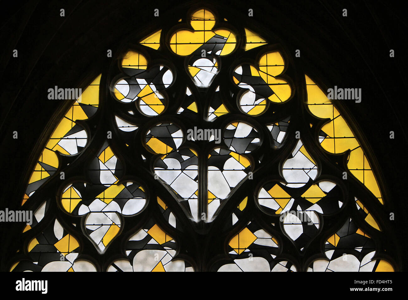 Contemporary yellow stained glass window. - Stock Image