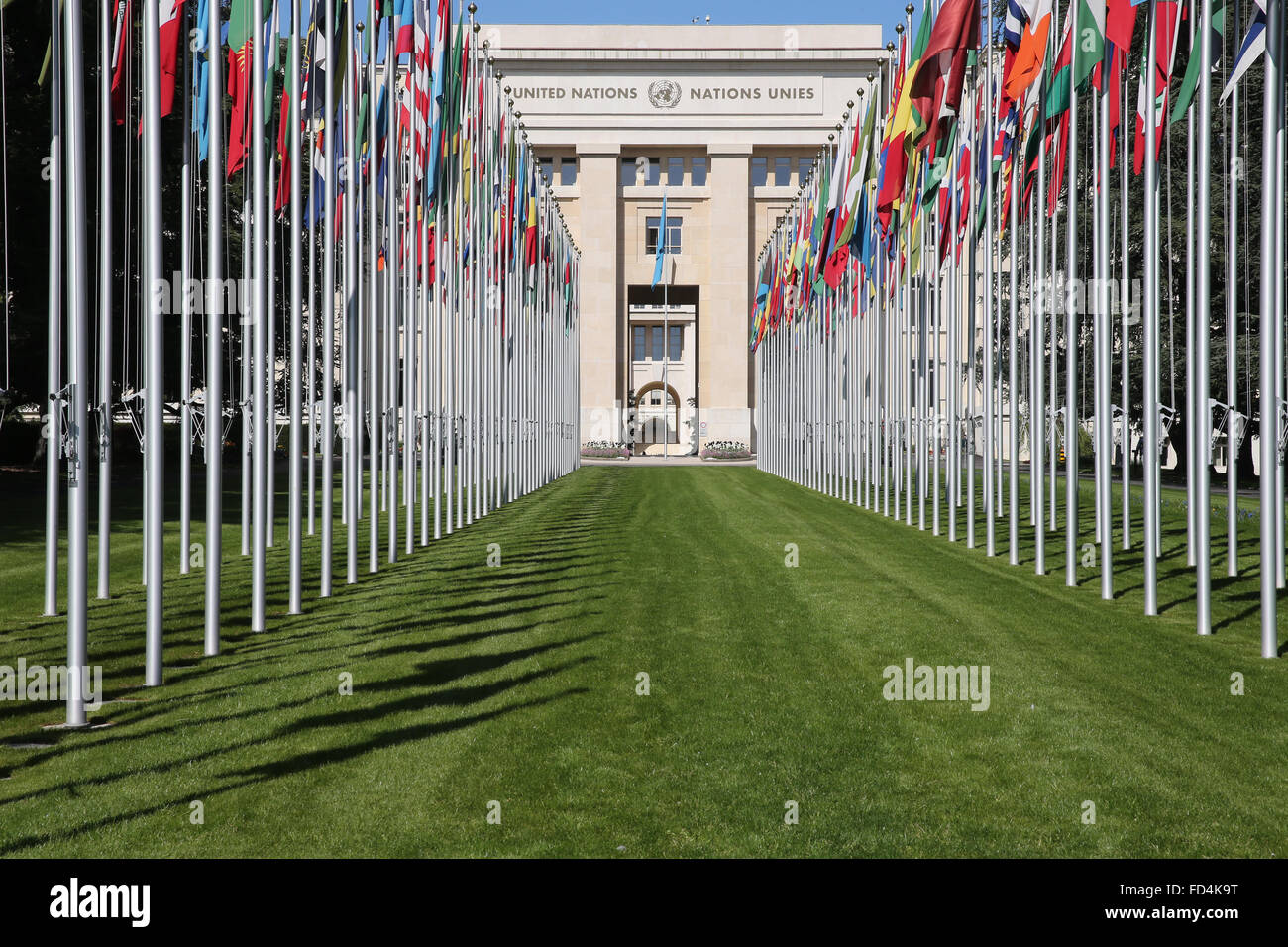 The flag lined approach to the entrance to the United Nations' Headquarters in Geneva. - Stock Image