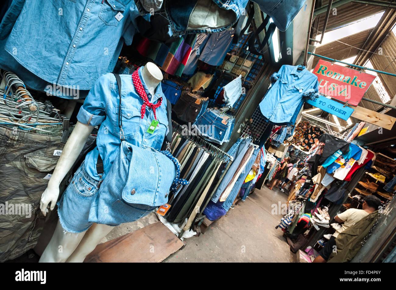 Vintage denim clothing at Chatuchak Weekend Market, Bangkok - Stock Image