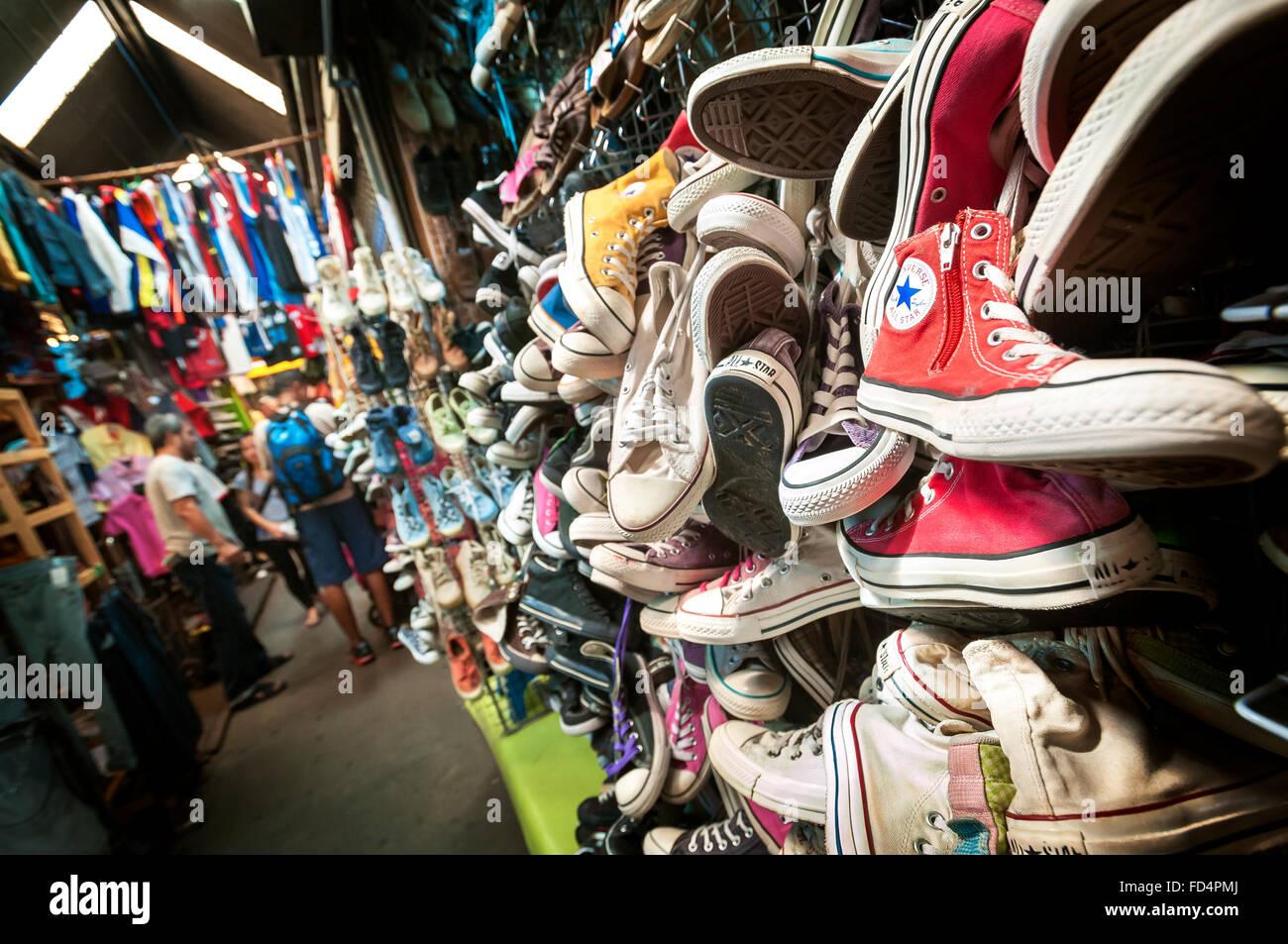 Old Converse trainers at Chatuchak Market, Bangkok - Stock Image