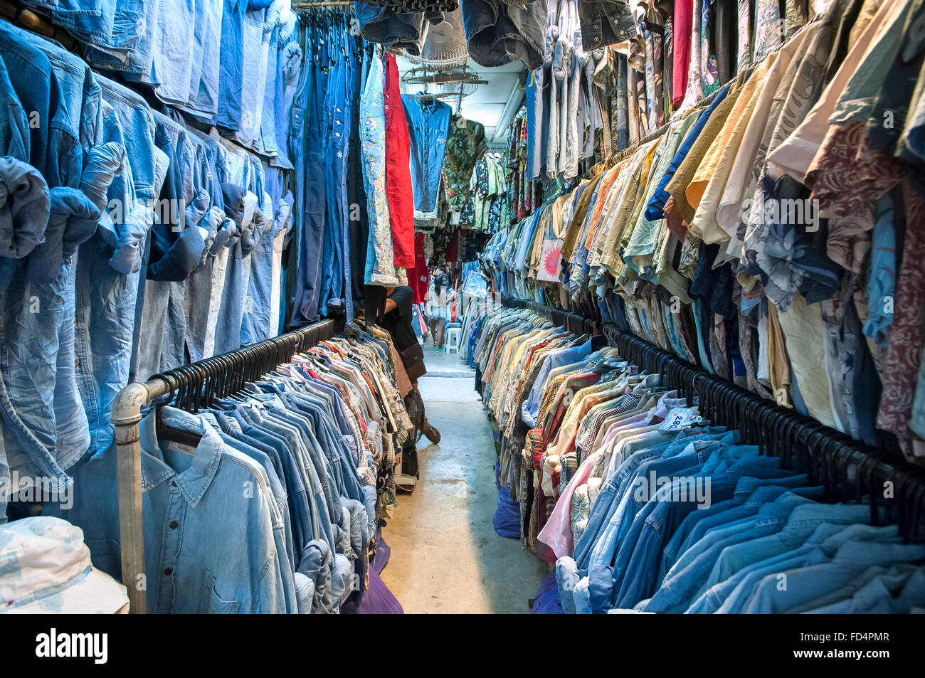Vintage shirts at Chatuchak Weekend Market, Bangkok - Stock Image