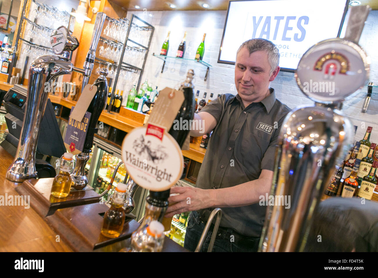 draught real ales for sale in a Yates Pub - Stock Image