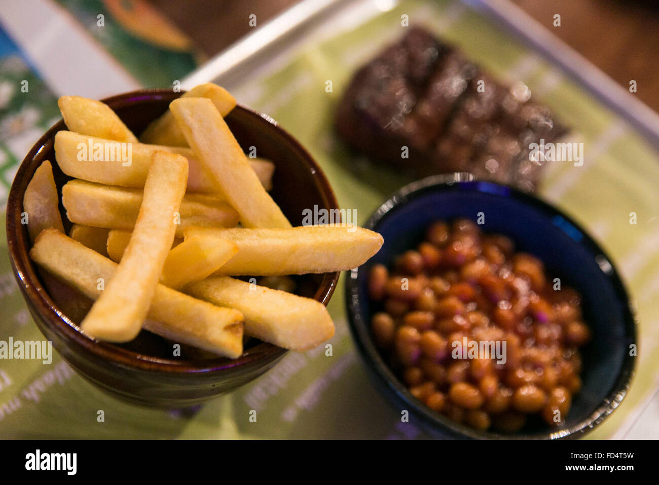 beans chips and steak meal in a pub - Stock Image