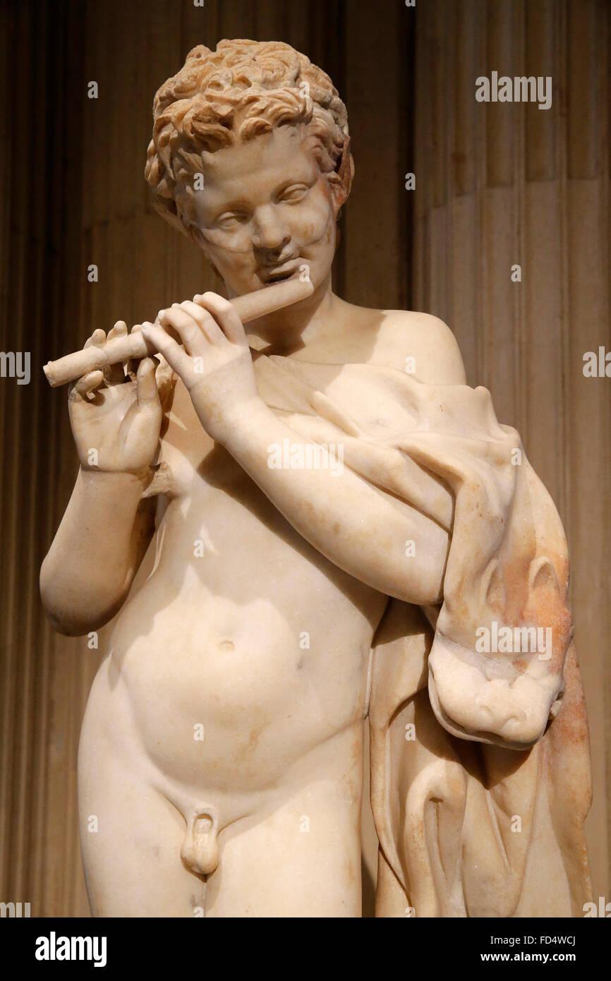 Louvre Museum. Paris. Satyre playing the flute. Second century AD. Italia. Marble of Paros. - Stock Image