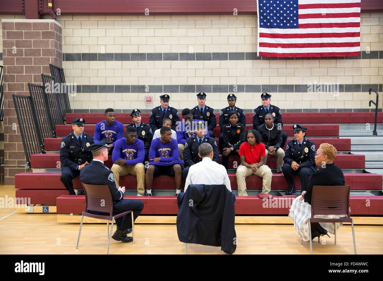 U.S. President Barack Obama talks with students and law enforcement officials about community relations and programs - Stock Image