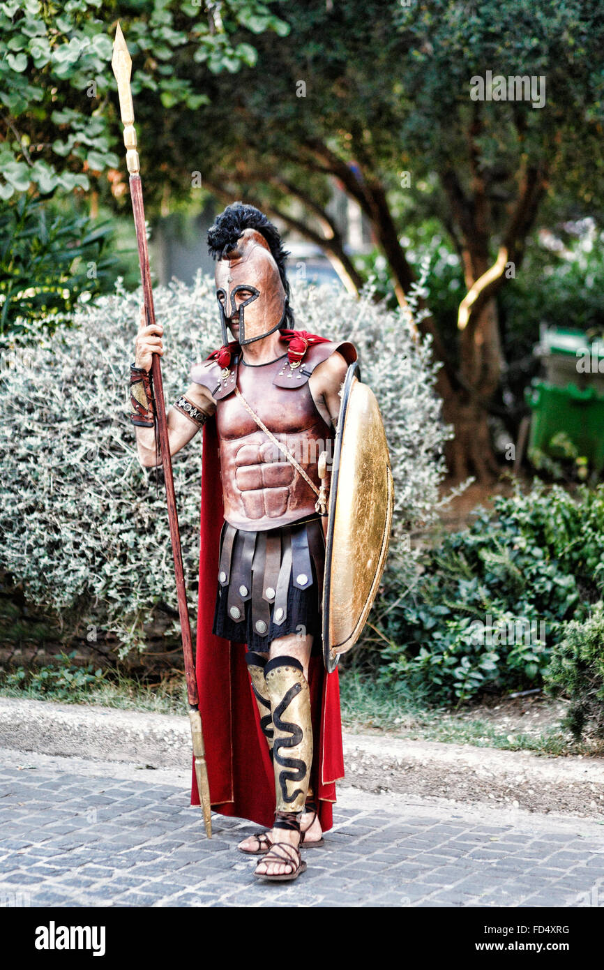 A man in costume of an ancient Greek warrior in the streets of Athens, Greece - Stock Image