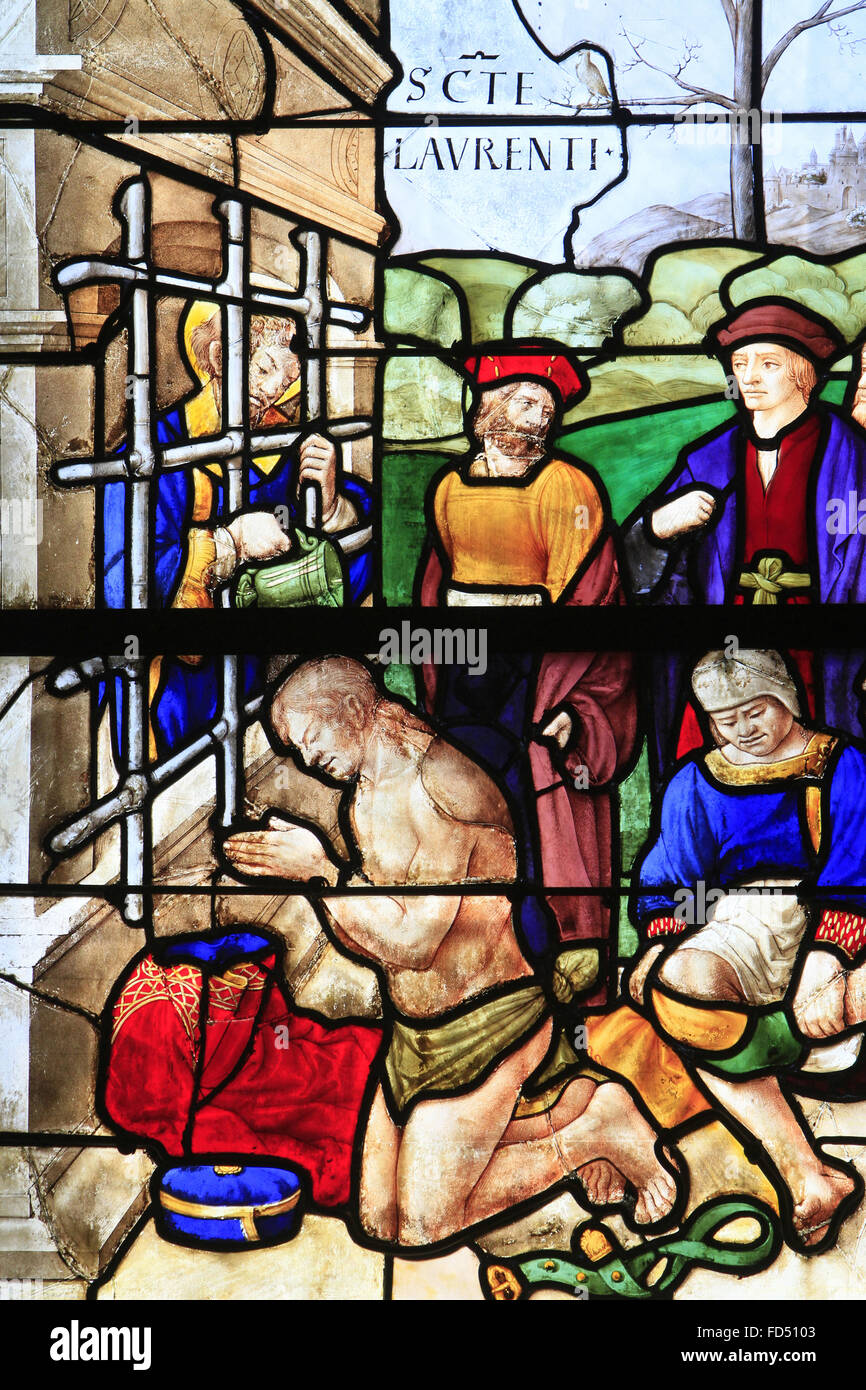 Stained glass window of the sixteenth century. Jean Lecuyer. 1535. St. Lawrence, deacon, behind the bars of his - Stock Image