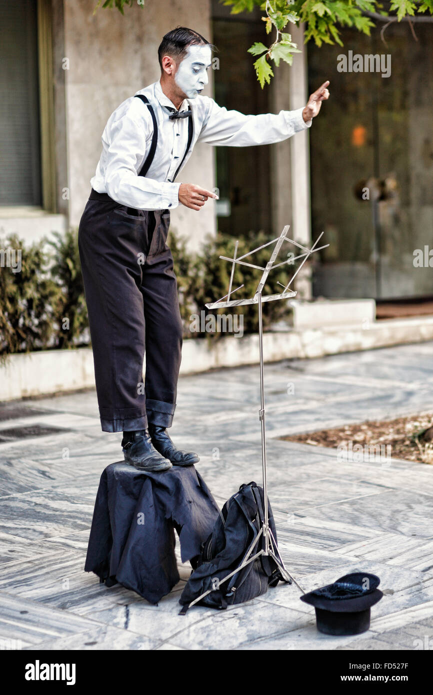 A mime performs in the streets of Athens, Greece - Stock Image