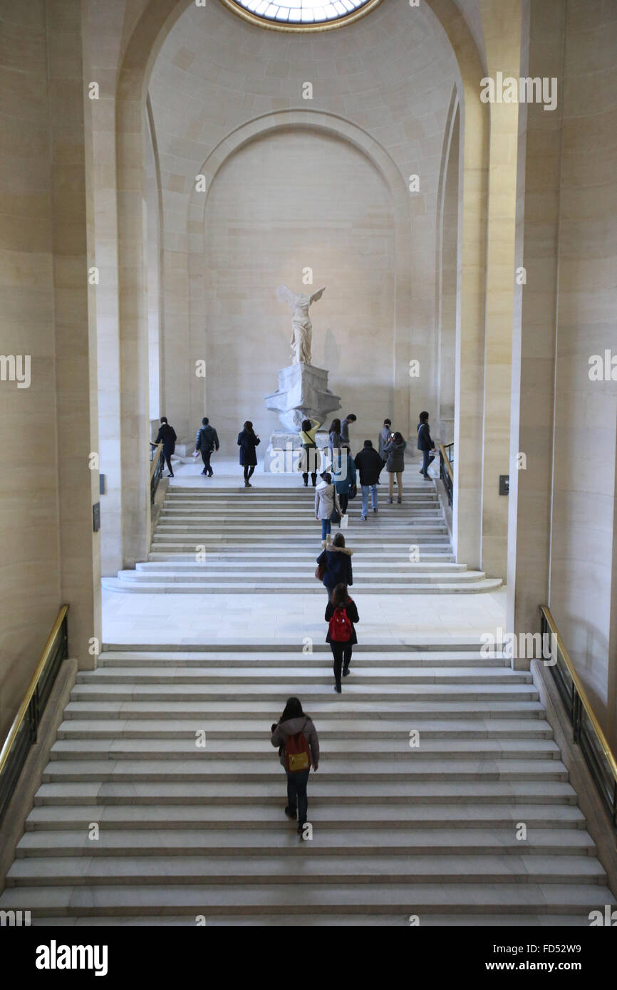 The Louvre Museum. Stairway and the Winged Victory of Samothrace. - Stock Image