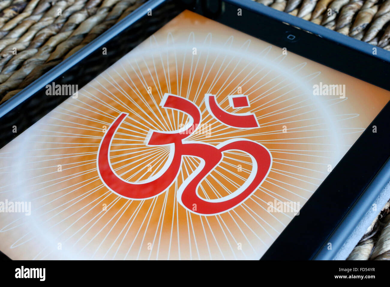 Om on an Ipad. The Om is a mantra and mystical Sanskrit syllable of Hindu origin. - Stock Image