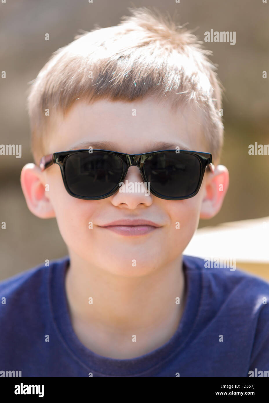 728e115ba947 Young boy wearing sunglasses outdoor portrait Model Release: Yes. Property  Release: No.