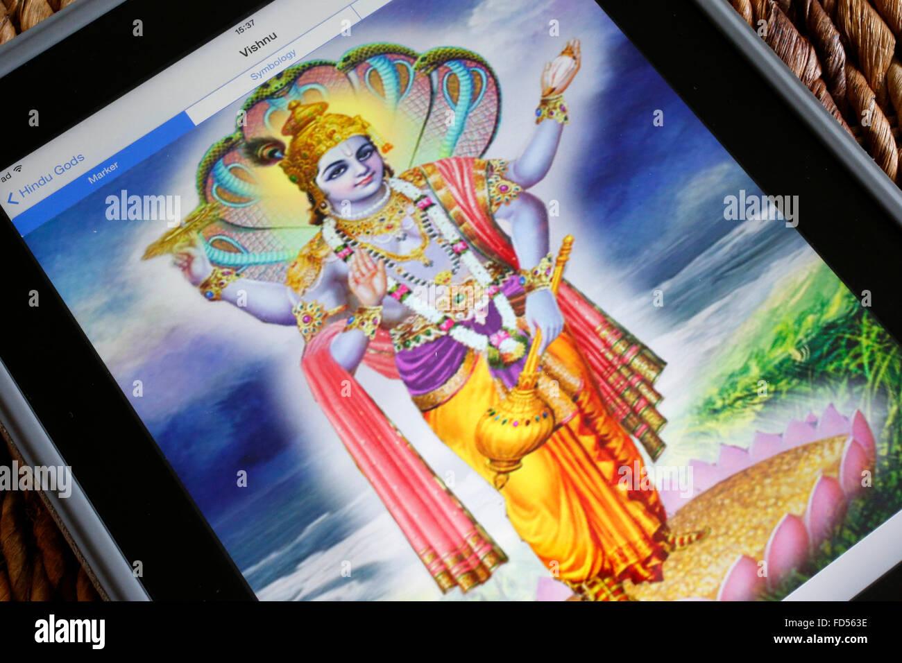 Hindu deity on an Ipad. Vishnu. - Stock Image