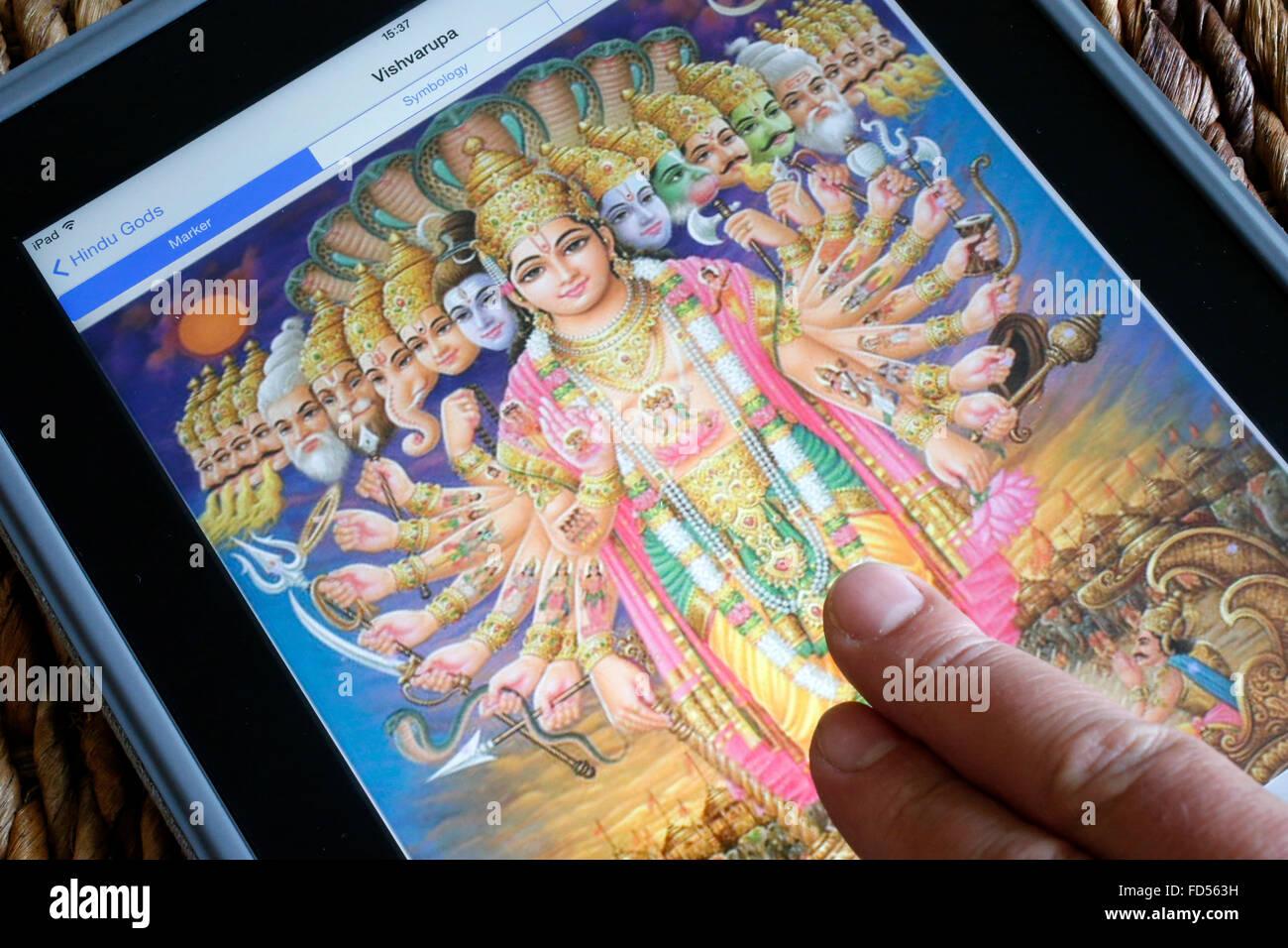 Hindu deity on an Ipad. Vishvarupa. - Stock Image