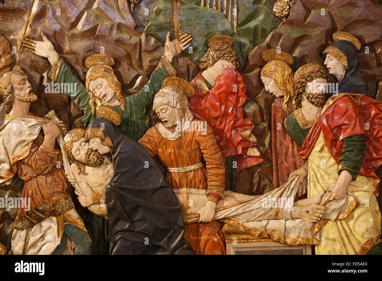 Sforza castle museum, Milan. Jesus laid down from the cross. 15th century. Carved, painted and gilded wood. - Stock Image