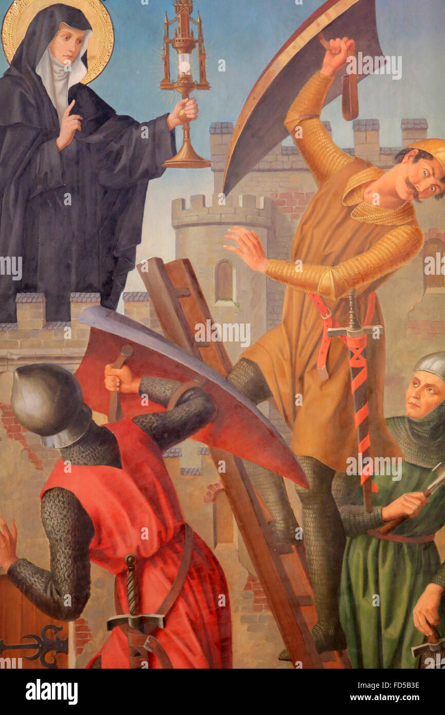St. Clair pushes the Saracens. Neo-Gothic triptych from the late 19th century. St. Stephen Cathedral of Metz. Stock Photo