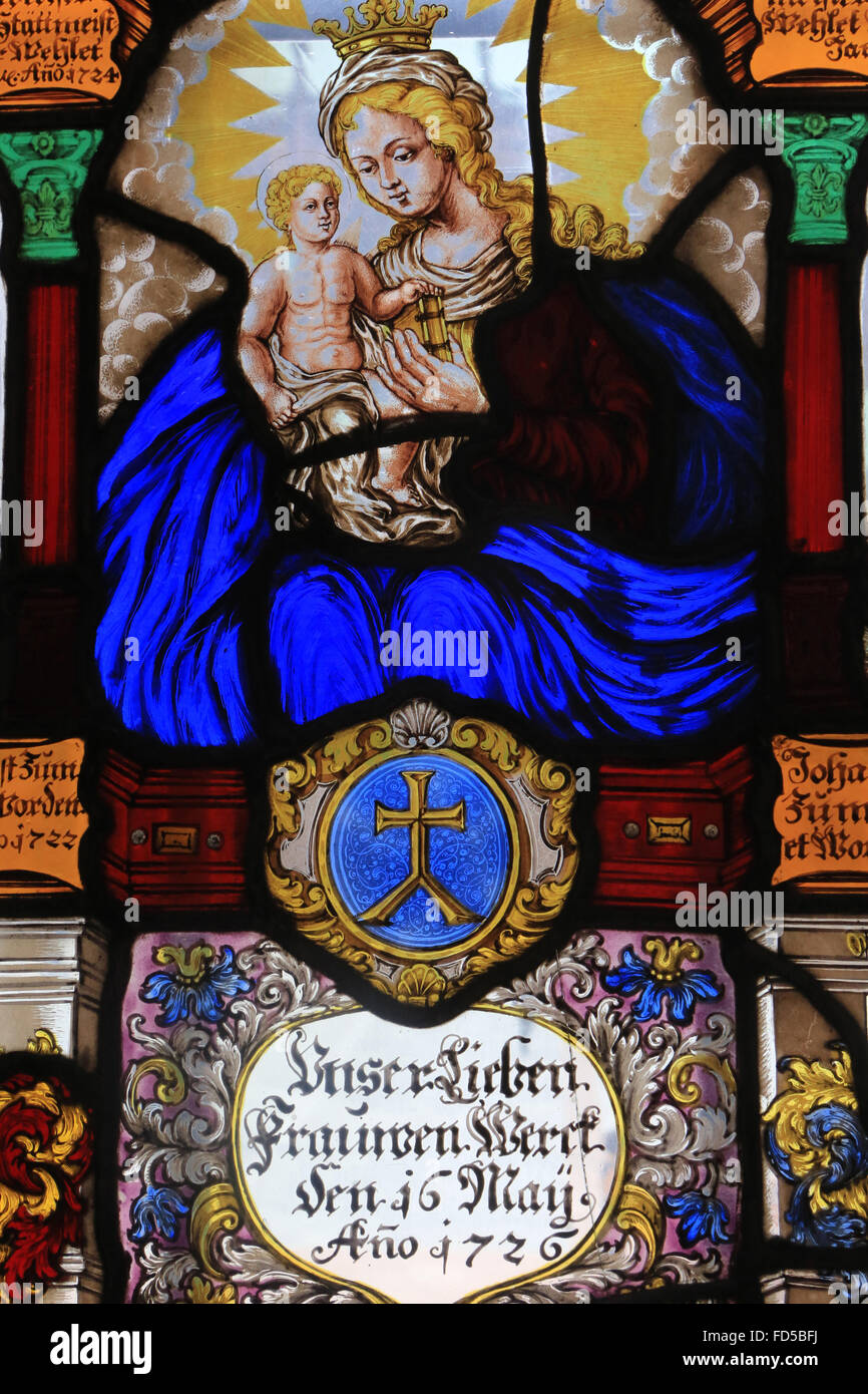 Heraldic stained glass work of Notre Dame with Virgin and Child in Glory. Starsbourg, 1726. Enamel painting on glass. - Stock Image
